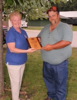 Matt Tyner (right) receives the Outstanding 4-H Leader Award from Rose Wall, president-elect of the Huntington Rotary Club, which sponsors the award, during a program at the Huntington County Fairgrounds' Heartland REMC Outdoor Stage on Monday, July 23. Tyner has helped lead the We Win 4-H Club in Dallas Township for 21 years.