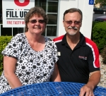 Judy (left) and Craig Lee take a break outside in front of the KFC Restaurant they own in Huntington. The couple is serving as the co-chairs of the Heritage Days festival steering committee. This is the second year they have headed up the five-day event.