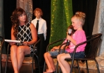 Little Miss Heritage Days contestant Kaylee Dennis (right) answers a question posed by Janelle Buzzard (left) during the interview portion of the annual pageant held Wednesday, June 15, at Crestview Middle School. Seated between them is contestant Zoe Curry. Kaylee is the daughter of Nick and Ashley Dennis, and Zoe is the daughter of Jaron and Megan Curry.