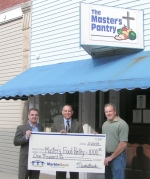 MarkleBank Vice President Andy Marshall (left) and Presdient and CEO Greg Smith (center) present Master's Pantry representative Brian James a check for the Master's Pantry food bank in Markle. Photo provided.
