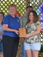 Rose Wall (left), representing the Huntington Rotary Club presents Machelle Suchcicki with a plaque designating her as the 2013 Huntington County Outstanding 4-H Leader on Saturday, July 20, at Hier's Park.
