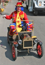 A clown drives down the Heritage Days Parade route in last year's celebration. This year's event, always one of the best-attended of the Heritage Days events, will step off Saturday, June 19, at 10 a.m.