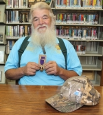 Chuck Iser, of Huntington, holds the Purple Heart medal he received during the Vietnam War.