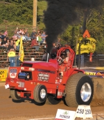 The front wheels of Travis Wisel's tractor lift off the ground as he pulls a weighted sled during the NTPA Tractor Pull at the 2013 Roanoke Fall Festival.