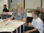 Joshua Rice (right) explains his reading project to project judge Christie Champ during 2010 4-H fair project judging on Thursday, July 22..