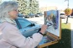 Rebecca Justice-Schaab, of Waterloo, was one of several plein air artists who painted on the street during the 2016 Renaissance in Roanoke art fair. The plein air artists, along with booths by artists and artisans, food, entertainment and children's activities, return this year on Saturday, Oct. 14.