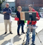 Plein air painter John Kelty (right) works on his watercolor while Bob Mansfield (left) and Cathy Eckert, both of Fort Wayne, watch during the Renaissance in Roanoke event last year in downtown Roanoke. This year's event takes place Saturday, Oct. 12.