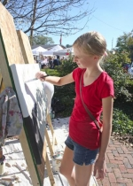 """Emma Parsley works on a community art piece during the 2013 edition of """"A Renaissance in Roanoke."""" The arts festival returns this year on Saturday, Oct. 11."""