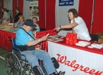 Pharmacist Robin Baker literally makes a point with J.R. Cramer, of Huntington, at the Walgreen's booth at last year's Huntington County Senior Expo at the Huntington University Merillat Physical Education Recreation Center. This year's event takes place Thursday, May 23, again at Huntington University.