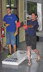 Mark Jeffers (right) flings a bean bag as opponent Drew Carey looks on during the Salamonie Summer Festival Corn Hole Tournament last year at Warren's old light plant.
