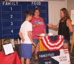 Treva Flemming (middle) poses a question to Wyatt Yoder (left), of the Yoder family, and Johnna Cummins, of the Sheets family, during a round of the Family Feud tournament held at the 2019 Salamonie Summer Festival. This year, the game will be held on Saturday, Aug. 22, at the Knight Bergman Center.