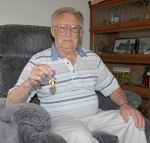"""Wilbert """"Curly"""" Seibold, a World War II Air Force veteran, holds his Purple Heart, which he received in August 1945 for injuries sustained in a plane crash. Seibold, 97, spent nine months as a prisoner of war following the crash."""