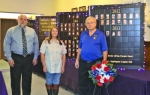 Huntington Mayor Brooks Fetters, Huntington resident Gloria Holzinger and Military Order of the Purple Heart Commander Larry Shaw stand with the traveling Purple Heart Memorial, which will remain on display at Huntington's City Building through Nov. 13.