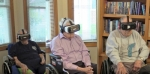 Leo Scheer, a resident at Heritage Pointe of Huntington, tries on virtual reality goggles showing a tour of the Honor Flight trip to Washington, D.C., and veterans memorial monuments. He, along with co-resident veterans Bill Jones and Bob Gernand, will be featured in a program to be shown tonight, Monday, Nov. 12, on WANE-TV.