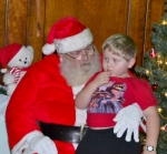 Tucker Mann thinks through his wish list with Santa Claus at the Knight Bergman Center, in Warren, on Nov. 28, 2014. Santa will arrive in Warren this year on Friday, Nov. 27, and supervise the lighting of the town Christmas tree before settling in at the KBC to hear Christmas wishes.