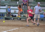 Erin Randol, playing for the Zanesville Redskins, connects during her turn at bat in last year's day-long  softball tournament at the Zanesville Homespun Day. The tourney returns to this year's activities lineup.