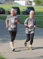 Kristi Hunnicutt (left) and Amy Butler near the homestretch of the Huntington County Run 4-Health 5K/10K/1M on Saturday, July 11, which started and finished at the Huntington County Fairgrounds.