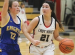 Huntington North High School varsity basketball player Leah Campbell drives past her East Noble opponent Anna Becker while looking for a teammate to pass the ball off to. The Lady Vikings took a win against East Noble on Friday, Jan. 8.