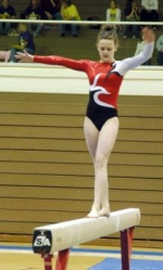 Huntington North High School freshman gymnast Jessica Baker concentrates as she performs on the balance beam on Friday evening, March 13, during the Huntington North Girls' Sectional Gymnastics Tournament.