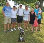 Proceeds from the Doug Boone Memorial Golf Outing on Aug. 5 were presented to toddler Sophia Sterling and her family, with the $4,000 raised designated to help with expenses associated with Sophia's cancer treatment. Making the presentation are (from left) Patrick Davis, golf pro at Norwood Golf Club; Tara Boone, Derek Boone and Terri Boone, Doug Boone's family; and Megan and Steve Sterling with children Olivia (front) and Sophia.