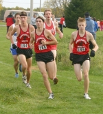 HNHS senior Josh Graham (center) leads teammates Ross Ochs (left) and Austin Roberts just after the 3K mark at the boys' cross country meet at Marion on Tuesday, Oct. 13.