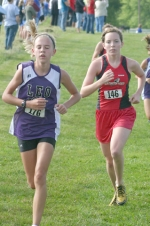 Huntington North girls' cross country runner Natalie Spahr has Leo's Lauren Hamilon in her sights during the Huntington North Cross County Invitational on Saturday, Aug. 22. Spahr placed seventh and HNHS was second as a team.