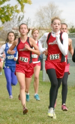 Freshman Robyn Karst (front) leads teammate Kayla Patrick (back left) during the girls' regional cross coutnry race at Marion on Saturday, Oct. 17. Karst and Patrick finished third and fourth, respectively, for the Lady Vikings.