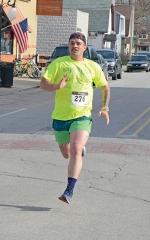Paul Bickel, of Huntington, churns for the finish line in the Discover Roanoke 5K on Saturday morning, April 13, in downtown Roanoke. Bickel won the race 18:54.7, more than two minutes ahead of the runner-up.