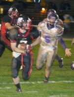 Austin Drummond of Huntington North Hgih School rushes for a two-point conversion against visiting Marion on Friday night, Oct. 9. The Vikings won 22-12.