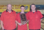 Huntington North High School sophomore E.J. Tackett (center) poses with his championship plaque and coaches Doug Scott (left) and Jim Bischoff after winning the Indiana High School state individual bowling championship at Anderson on Saturday, Feb. 21.