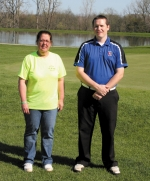 Jennifer Fisher (left), co-chair of American Legion Post 7 fireworks, and Patrick Davis, head golf pro at LaFontaine Golf Club, stand together on the fairway, after discussing details of the golf outing, planned to benefit the July 4, fireworks display.