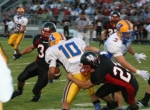 HNHS Viking Matt Kramer (No. 23) takes down Homestead's Steven Espinoza (No. 10), as Viking Nick Miller (No. 34) gets ready to assist in the tackle.