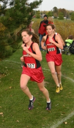 Huntington North's Spahr sisters, Gretchen (front) and Natalie, lead the competition after the 2K mark durng the girls' cross country sectional at Marion on Tuesday, Oct. 13.