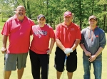The winning team in the Kids Kampus golf outing on May 13 was made up of (from left) Neil Kline, Brandy Swope, Jeff Wing and Tim Wing.