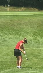 Preparing to hit her golf ball at the Huntington North Golf Invitational on Tuesday, Aug. 4, is junior Haley Newton. The invitational was held at Clear Creek Golf Course and hosted 13 other schools.
