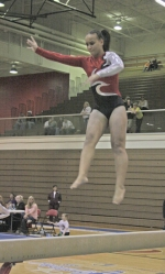 HNHS freshman Stephanie Freeman gets some air during a maneuver on the balance beam at the Huntington North Rgional Gymnastics Tournament on Friday, March 12. Freeman qualified for the state meet on the uneven bars.