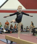 Lauren Minnick, a Level 2 competitor with Huntington Gymnastics Academy, performs her routine on the balance beam during the Turkey Tumble, a meet organized by HGA and held in the Huntington North High School Fieldhouse on Sunday, Nov. 15.