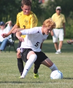 Huntington North midfielder Trey Sorg fights off Aidan Hinesley of Snider for possession of the ball during the Vikings' home soccer match on Tuesday, Aug. 20.