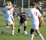 Huntington North freshman Courtney Christle is surrounded by Columbia City defenders during action at the Homestead Girls' Soccer Sectional on Tuesday, Oct. 8. The Lady Vikings won, 2-0.