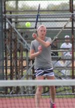 Huntington North's second singles player Kari Bard  is all concentration as she returns a shot during her match against Adams Central's Lydia Johnson on Tuesday, May 7.