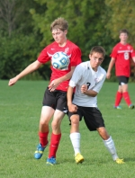 Huntington North senior Tyler Henline (right) battles a Richmond player for the ball during the Vikings' soccer game at home on Saturday, Oct. 5. The Vikings won 2-1.
