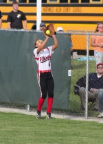 Huntington North right fielder Maddi Kennedy gets underneath a foul ball during the Lady Vikings' 1-0 win voer Carroll in the Huntngton North Softball Regional on Tuesday, May 28.