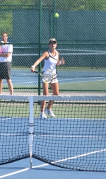 Huntington North's No.1 singles player, Kylie Fredrick, returns a shot during sectional play against Norwell on Thursday, May 16. Fredrick won her match and helped HNHS advance to the championship tonight, Friday, May 17, against Adams Central.
