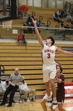 Huntington North High School varsity basketball player Zach Hubartt leaps to make a two-point basket during a home competition against the Columbia City Eagles.