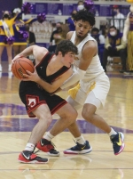Wyatt Dohrman, a Huntington North High School basketball player, attempts to keep possession of the ball during competition against the Marion High School Giants on Saturday, Feb. 20. The HN Vikings took a win against their hosts that evening.