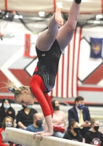 Chloe Camomile, a Huntington North High School junior, takes part in a varsity beam routine during Huntington's first meet of the season on Tuesday, Jan. 5.