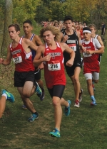 Huntington North's JJ Whicker (middle) and Jacob Wust (left) turn a corner near the beginning of the Marion Boys' Cross Country Regional, held Saturday, Oct. 15, on the Indiana Wesleyan University Cross Country Course. Whicker and Wust placed sixth and eighth, respectively, to help the Vikings win the race.
