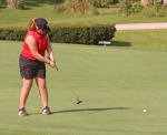 Danielle Gonser, a senior on the Huntington North High School girls' varsity golf team, putts during a match against visiting Mississinewa on Tuesday, Aug. 28, at Norwood Golf Course. Gonser scored a 51 and the Lady Vikings won the match, 174-222.