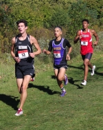 Elijah Chesterman (third from left), a senior on the Huntington North High School boys' cross country team, keeps pace with Eastbrook's Conner White (first from left) and Marion's Jalen Springer during the Marion Boys' Cross Country Sectional, held Saturday, Oct. 8, on the Indiana Wesleyan University Cross Country Course. Chesterman beat both White and Springer to the finish line, taking third in 16:25.9, which helped the Vikings win the sectional title.
