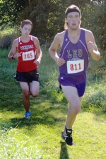 Huntington North freshman Jacob Wust (left) keeps pace with Leo's Nathan Werling at the Huntington North Cross Country Invitational, held Saturday, Aug. 22, on the Huntington University Cross Country Course.